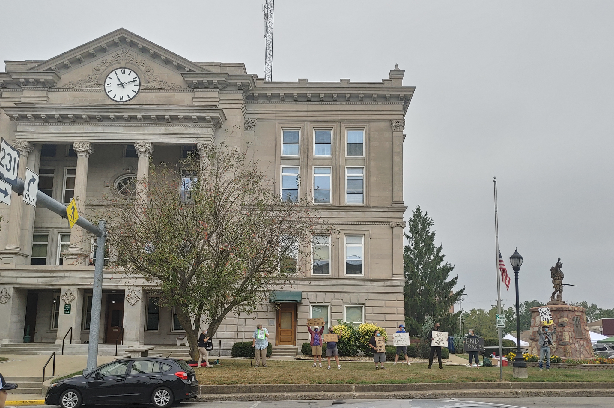 Protesters gathered outside the Putnam County court house. Photo By Ian S. Brundige