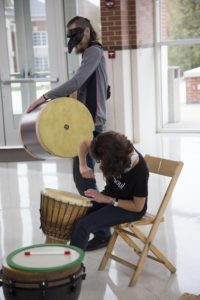 Faculty joins the drum circle to entertain the children around. GERALD PINEDA / THE DEPAUW