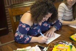 Freshman Maria Flores colors in a coloring book as a way of relieving stress from her everyday life. GERALD PINEDA / THE DEPAUW