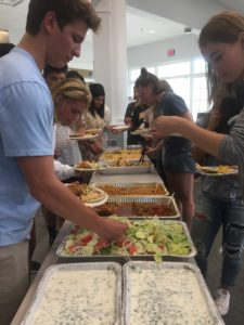 Students enjoy Indian food during the Eid celebration Remsha Khan