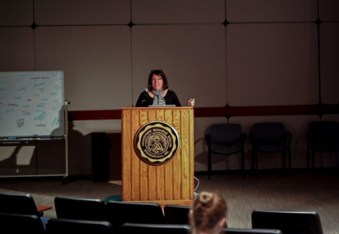 Sara Quinn, the President of the Society for News Design, giving a speech in Watson Forum on photography for journalismNATALIE BRUNINI