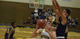 Senior forward Jack VandeMerkt drives up to the basket during the Tigers' 90-72 win over Franklin in the season opener earlier this month. Photo by Madeline Green