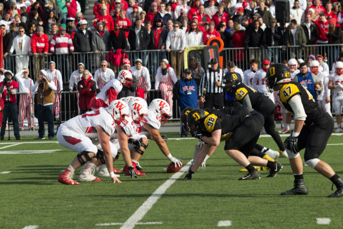 DePauw's defensive line matches up with Wabash's offensive line BYRON MASON II